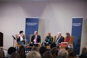 Desha Girod, Ban Ki-Moon, Mary Robinson, Jerry Brown and Rachel Bronson sits on a stage with Georgetown University banner behind them