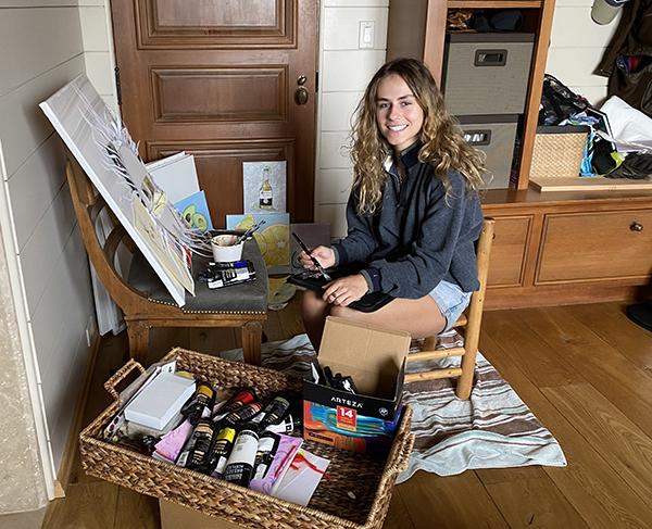 Libbie Blume sitting in a chair